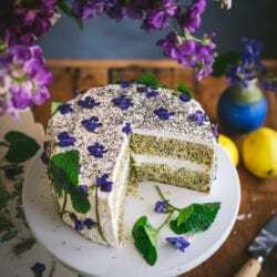 lemon poppy seed cake with Swiss buttercream frosting decorated with wild violets