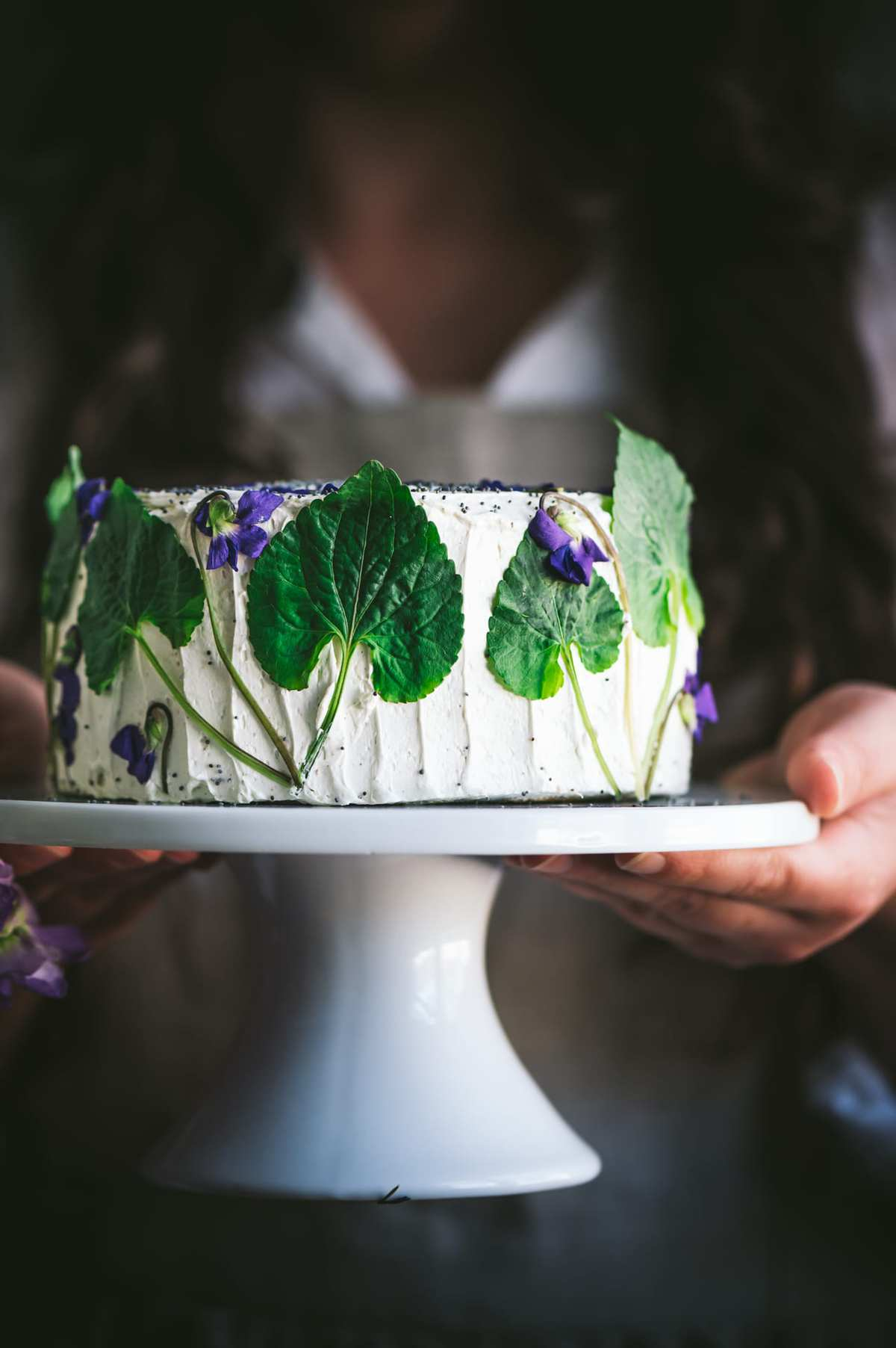 emon poppy seed cake with Swiss buttercream frosting decorated with wild violets