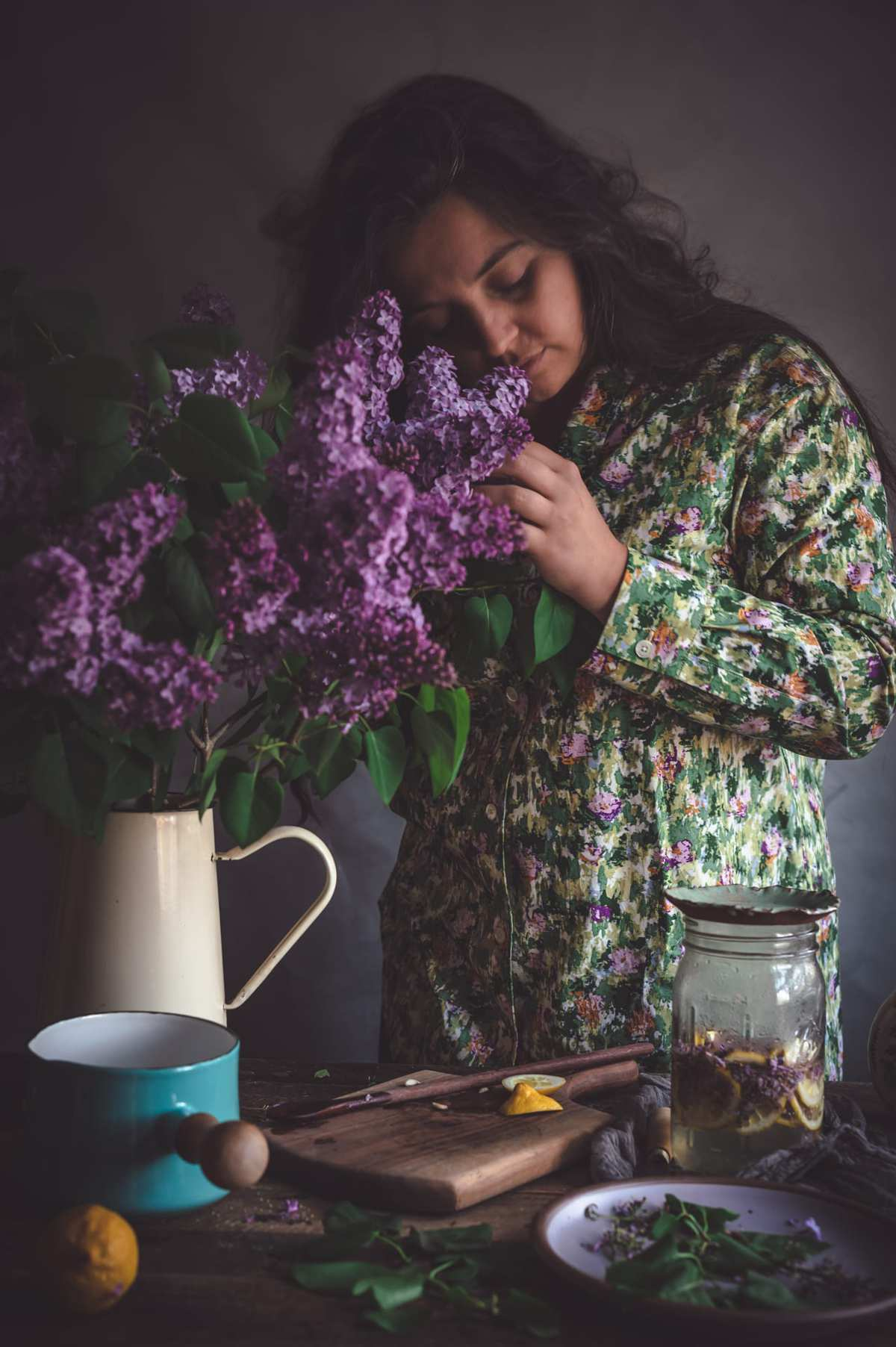 woman smelling lilacs